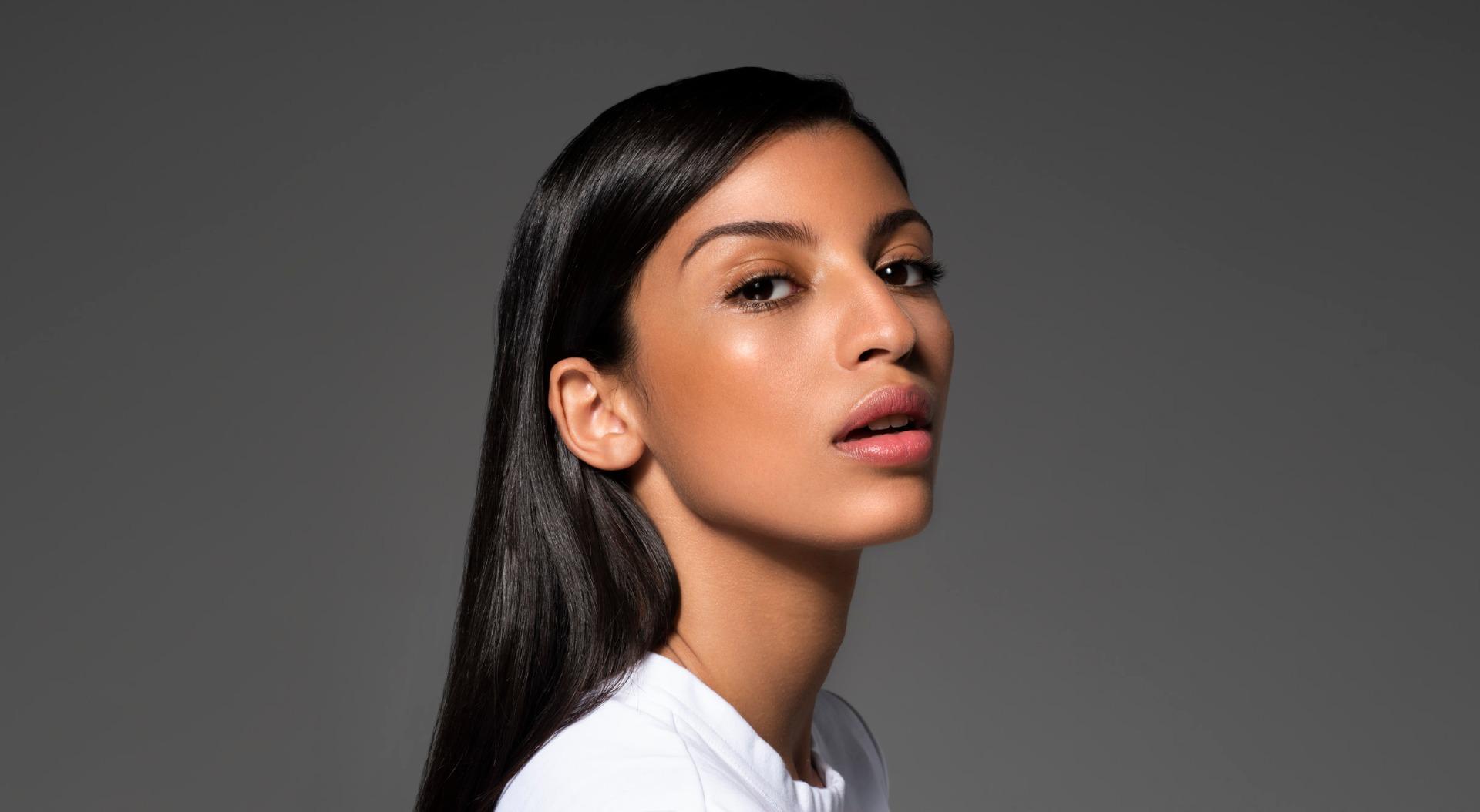 Woman Wearing Makeup & SPF