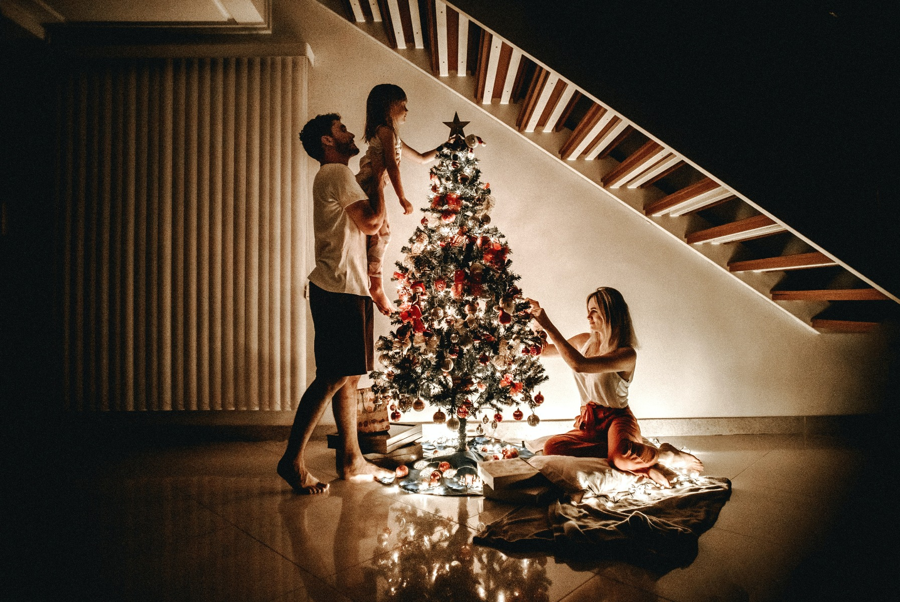 Family Putting Up Christmas Tree